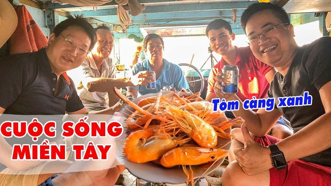 kham-pha-cuoc-song-tren-cho-noi-long-xuyen-thuong-thuc-tom-cang-xanh-hap-nuoc-dua